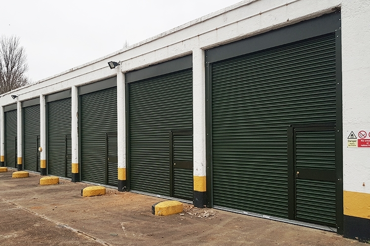 Roller shutter doors with wicket inset at Bassingbourn barracks
