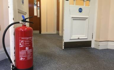 Fire Door Propped Open with a Fire Extinguisher