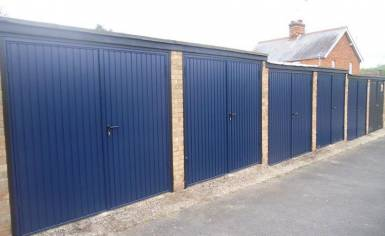 Side hinged garage doors for landlord